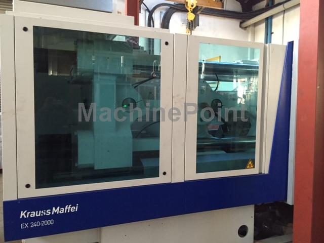 去  Injection molding machine up to 250 T  KRAUSS MAFFEI EX 240-2000